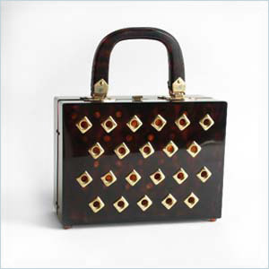Boxy, tortoiseshell-colored lucite bag
